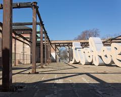 Pillars (BradPerkins) Tags: railroad urban streetart chicago building history lines weird shadows circles platform rail foundation pullman rails pillars nationalmonument urbanlandscape historicsite