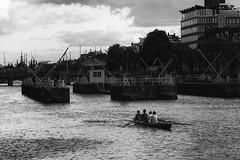 (giovanibr) Tags: life street bridge blackandwhite bw netherlands amsterdam sport river boat europa europe streetphotography canoe magerebrug holanda practice canoeing dugout amstel skinnybridge