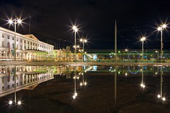 Kauppatori Reflections, Helsinki (flatworldsedge) Tags: longexposure cloud blur reflection night puddle helsinki cloudy pov flag tram groundlevel cobbles improvisedtripod