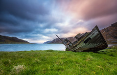 Abandoned boat (Mikko Lnnberg) Tags: longexposure sunset sea summer sky mountain seascape abandoned beach norway clouds landscape boat scenery mikkolnnbergphotography
