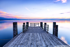 Silence, Peace and Water (PhilippN.83) Tags: chiemsee chiemgau steg sunset sonnenuntergang pier water lake see wasser blaue stunde blue hour sky violet lila red rot wood holz canon eos 70d mirror spiegel licht light bavaria bayern