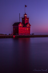 Big Red Bathed in purple. (ChristineDarnell) Tags: sunset purple red lighthouse michigan lakemichigan longexposure bigredlighthouse hollandmichigan canon canon7dmarkii canonef1635mmf4lisusm christinedarnell lake water