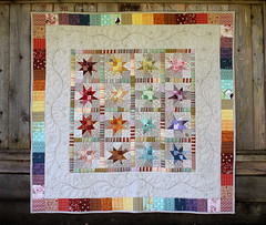 Rainbow Star Quilt (PatchworkPottery) Tags: rainbow quilt handmade feathers pebbles quilting quilted block patchwork freemotion wonkystar