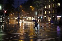 Crossing (maekke) Tags: street woman color rain umbrella canon 50mm switzerland evening availablelight f14 streetphotography bluehour zrich ch zrichhb 2016 zrichhauptbahnhof eos6d