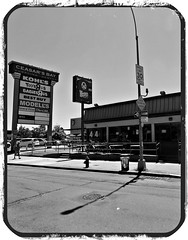 Shopping Center @ Caesar's Bay (Robert S. Photography) Tags: shoppingcenter ceasarsbay sign wendys fastfood man walking street summer reflection sun brooklyn new nyc bayparkway bw nikon coolpix l340 iso80 august 2016
