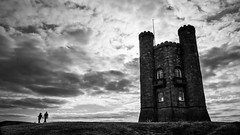 The Broadway tower - Broadway, United Kingdom - Black and white street photography (Giuseppe Milo (www.pixael.com)) Tags: streetphotography light sun monochrome fujix sky unitedkingdom street ultrawide black city blackandwhite fujixe2 uk fujifilm clouds xe2 fuji urban fuji14 candid travel photo photography fuji14mm bw contrast europe geotagged white broadway england gb onsale landscape