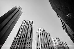 Jumeirah Beach Residence, Dubai, United Arab Emirates (Seven Seconds Before Sunrise) Tags: travel bw building window architecture asia dubai cityscape uae middleeast unitedarabemirates dubaimarina jumeirah jumeirahbeachresidence myuae mydubai dubaimarinajbr