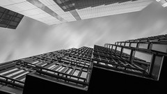 - Sharp Edges Look UP - (Mr. LookUP) Tags: blackandwithe blackwhite bw architecture urban urbanphotography urbanexplore lookup london greatbritain clouds movement photography photoshop unique windows wideangle