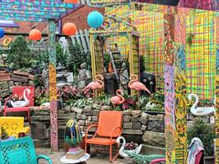 Randyland (dckellyphoto) Tags: pa pittsburgh pittsburghpa pittsburghpennsylvania alleghenycounty pennsylvania sand chairs table alligator flamingo painted paint bright colorful randyland