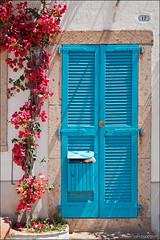 bosa (heavenuphere) Tags: oristano sardegna sardinia sardinie italia italy europe island blue louvre door pink flowers bougainvillea 24105mm