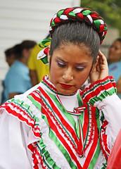 Preparing to Dance (Ellsasha) Tags: dancers performers mexican houston