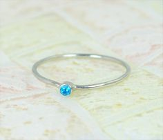 Tiny Blue Topaz Ring (alaridesign) Tags: tiny blue topaz ring set solid white gold wedding stacking december birthstone mothers by alaridesign
