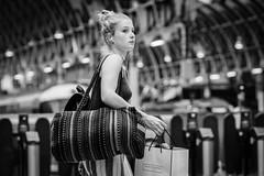 Paddington Girl (jonron239) Tags: london worldphotographyday railway station canopy victorian girl bun vest blonde bag patterns glance