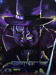 Graffitis Supervillanos - El Pingino (damargo1983) Tags: fuenlabrada parquedelasolidaridad elpingino streetart urban graffiti arte mural supervillano villano violeta morado sombrero comic dccomic batman malvado colors color colours colores luz light arteurbano purple