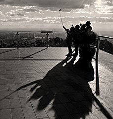 Skyhigh at Mt Dandenong (phunnyfotos) Tags: phunnyfotos australia victoria vic melbourne dandenongranges dandenongs thedandenongs skyhigh tourism tourists selfie selfies group people mono bw monotone view outlook deck observationdeck observatory nikon d5100 nikond5100 shadow shadows silhouette silhouettes selfiestick photo mountdandenong mtdandenong