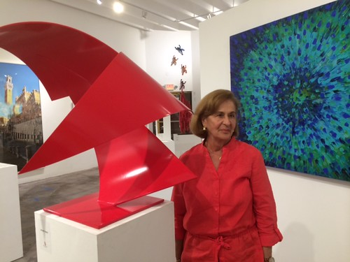 Diana Font, from Venezuela, with her sculpture at Curator's voice projects opening night at the Wynwood Art walk