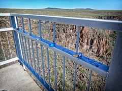 Padlocks on Rio Grande Gorge Bridge (moonglampers) Tags: bridge newmexico love suicide rail devotion gorge taos nm padlock padlocks riogrande neartaos