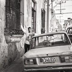 this car is mine (Gerard Koopen) Tags: cuba santiagodecuba santiago straatfotografie streetphotography straat street man car oldcar lada bw blackandwhite candid fujifilm fuji x100t 2016 gerardkoopen