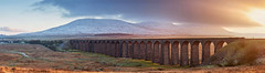 Ribblehead Pano (matrobinsonphoto) Tags: park bridge winter light sunset england sky panorama sun sunlight snow building simon architecture train landscape outdoors golden countryside moss track arch head pano yorkshire hill north wide dramatic railway arches trains panoramic line viaduct hills national valley hour summit peaks capped carlisle fell dales settle ingleborough ribbleheadviaduct ribblehead ribblesdale riverribble settlecarlislerailway yorkshiredalesnationalpark battymoss battymossviaduct