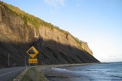 morning on the outskirts of the village (Ultrachool) Tags: landscape cliff hills quebec montstpierre rocks gaspepeninsula water shadows signs