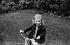 NegativeRoll0010002.jpg (The Digital Shoebox) Tags: madeinusa blackandwhite amateurphotographer people ebay children foundfilm monochrome negative unidentified memories scan original found ponytail outside family tricycle 35mm kodak
