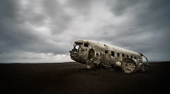 Crashland. (Luke Sergent) Tags: old travel abandoned tourism beach broken nature beautiful metal plane vintage airplane landscape lost coast us iceland sand tour shot desert natural crash accident outdoor steel destruction aircraft aviation military south united transport navy wing apocalypse scenic cockpit landmark tourist aerial vik landing southern transportation disaster damage land lonely bullet states unusual wreck emergency damaged crush dc3 epic remains destroyed wreckage survival wrecked explode sights attraction apocalyptic catastrophe icelandic fuselage postapocalyptic kp9 solheimasandur kp8