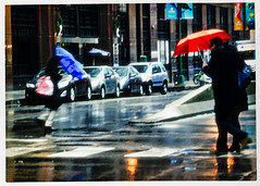 Strange News From Another Star (swanksalot) Tags: umbrella red blue rain chicago westloop strangers streetlife reflection blur availablelight tweeted