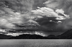 Thunderstorm, Harrison Lake (martincarlisle) Tags: thunderstorms harrisonlake echoisland harrisonhotsprings britishcolumbia canada water lakes islands mountains clouds sky storms weather darkclouds pentaxk5 pentaxians pentaxart tamronlenses niksoftware colourefex silverefexii blackandwhite monochrome