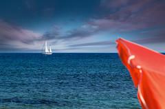 Barca al tramonto (Marco Brunetti) Tags: boat sicily seascape mare pentaxk30 hdpentaxda1685 sea isoladellecorrenti
