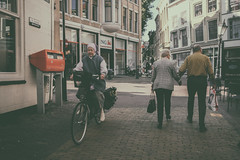 Vintage Gouda (PaulHoo) Tags: gouda holland netherlands fuji x70 city urban citylife candid streetcandid streetphotography 2016 vintage nostalgic vignette people cycling bike elderly