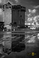 Torre Aragonese, Porto Torres (Luca eskimo) Tags: bn bw portotorres tower torrearagonese tirrenia porto port ship reflex mirror water street clouds specchio riflesso sardegna sardinia autolavaggiobatman symmetric simmetrico