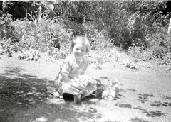 Girl in the garden (vintage ladies) Tags: summer portrait people blackandwhite girl smile smiling female vintage sitting child lovely 40s 40sstyle