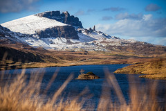 The Old Man of Storr, Isle of Skye, Scotland (Zoltan Gabor) Tags: old uk blue sky mountain lake snow man skye nature rock clouds canon landscape scotland isleofskye snowy hill ngc hills loch isle oldmanofstorr storr leathan