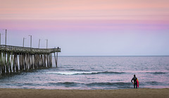 Surfer at Sunset (cosmoguy1) Tags: ocean pink blue sunset color beach beautiful virginia pier sand surfer surfing atlantic hue