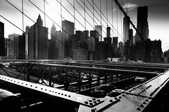 On the Brooklyn bridge (Luc Neuville) Tags: city bridge sunset urban bw newyork car brooklyn voiture line pont ville ligne