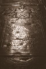 Gravestone in church @ Maastricht (PaulHoo) Tags: maastricht bw blackandwhite monochrome 2016 limburg holland netherlands city urban lumix detail grave gravestone engravings light sepia interior church vignette vignetting