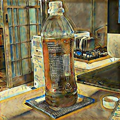 Still Life with Squished Computer and Tea Bottle 2 (sjrankin) Tags: 18july2016 edited processed filtered yubari hokkaido japan tea bottle teabottle door computer