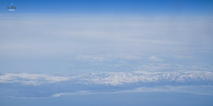 Eastern shore of Siberia/North Asia (A. Wee) Tags: inflight flying aerial view northasia siberia beringsea