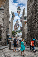 Hanging Canoes ... (Marty 1955 ...) Tags: canada quebec street stone people candid martyleclercphotography skies clouds cloudy cobblestone buildings road canoe floating