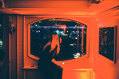 City Lights (Louis Dazy) Tags: red film window girl night analog 35mm photography lights boat nikon mood flare 100 f2 nikkor ai ektar