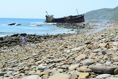 Distant Wreck (Bob Hawley) Tags: sea people landscape outdoors coast rocks asia ships taiwan wrecks piri pingtung nikon1755f28 hengchunpeninsula vividstriking nikond7100 jiupengbeach