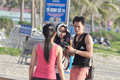 Snapper snapped (Roving I) Tags: canon models smiles expressions photographers vietnam cameras beaches adidas ponytails danang realisation
