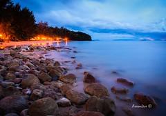 Twilight Beach (axxonlive) Tags: sea tourism beach nature rock landscape twilight soft outdoor stones wave sarawak sands kuching damai beachday damaicentral