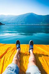Relax on the piers (Nicola Pezzoli) Tags: blue italy mountain lake tourism water colors yellow canon reflections relax dof piers floating bergamo brescia lombardia christo iseo