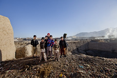 Children at Quadrabad 9990 (shahidul001) Tags: people child children kid kids boy boys pakistani pakistanis poor indigent poverty slum shanty shandtytown quadrabadslum shacks home homes mudhome mudhomes horizontal color colour day daylight quetta pakistan southasia asia drik drikimages