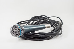Singin Microphone and wire cable  isolated on a white background. Music. (themusicianlab) Tags: music white black classic broadcast electric metal closeup illustration radio silver studio handle concert wire aluminum media technology singing song metallic background object band scenic voice nobody cable professional communication equipment entertainment musical chrome electronics single broadcasting sound instrument record karaoke microphone mic interview speech audio isolated speak scenical