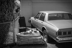 (226/366) Flat (CarusoPhoto) Tags: alley car flat tire bricks bw black white john caruso carusophoto pentax ks2 hd pentaxda l 1850mm f456 dc wr re hdpentaxdal1850mmf456dcwrre photo day project 365 366 banal mundane ordinary everyday