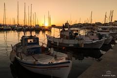 Sunset in Aegina (outonalymm) Tags: aegean aegeansea aigina aiginatown kaiki marina saronic saronicgulf sunset fishingboat harbour yachts