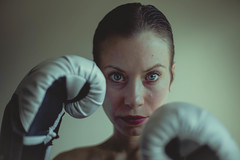 Hands, stomach and heart (gianteyephotography) Tags: conceptual photography female model boxing box gloves fight defend protection protect window lit natural light fighting blue eyes