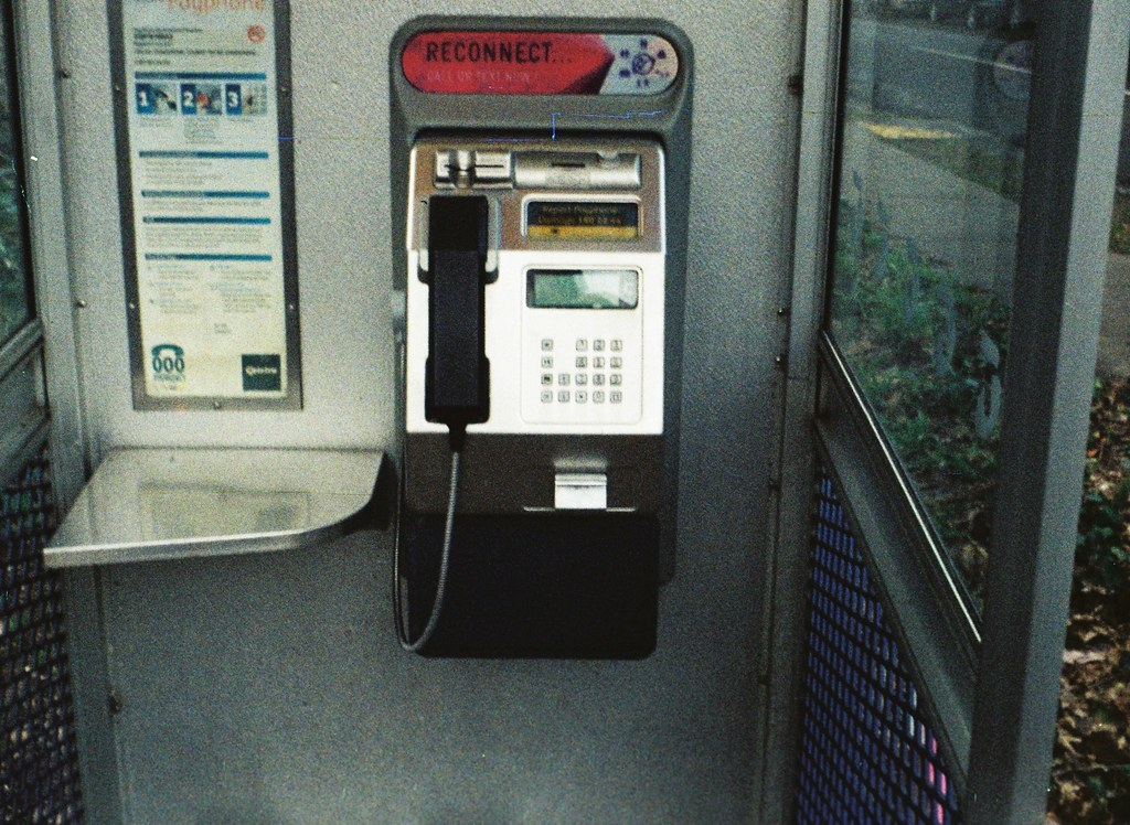 how to open a telstra payphone